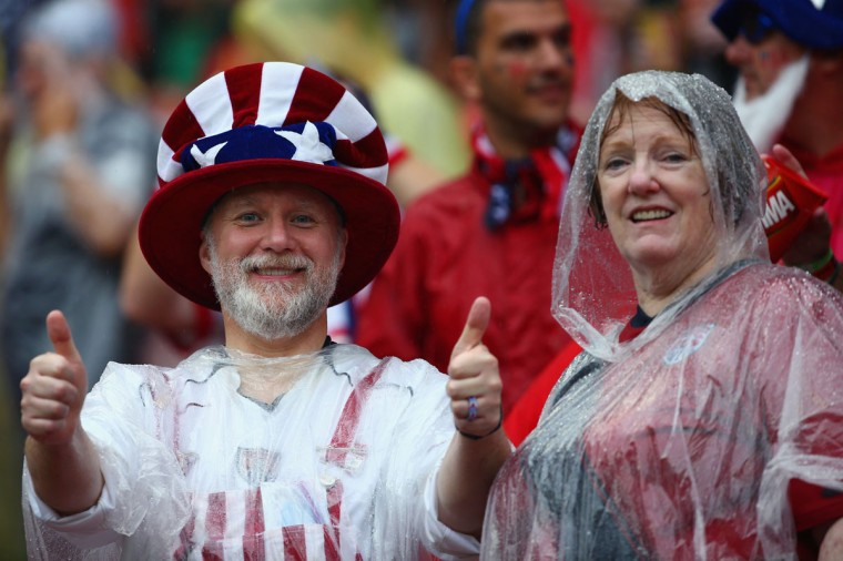 United States fans look on in the rain prior to the 2014 FIFA World Cup Brazil group G match between the United States and Germany at Arena Pernambuco on June 26, 2014 in Recife, Brazil. (Photo by Robert Cianflone/Getty Images)