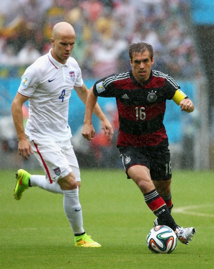 Philipp Lahm of Germany controls the ball against Michael Bradley of the United States during the 2014 FIFA World Cup Brazil group G match between the United States and Germany at Arena Pernambuco on June 26, 2014 in Recife, Brazil. (Photo by Robert Cianflone/Getty Images)