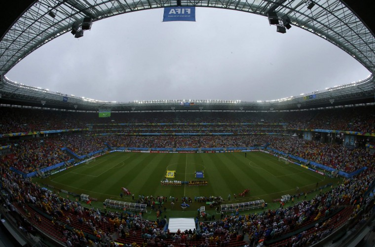Rain pours ahead of the 2014 World Cup Group G soccer match between the U.S. and Germany at the Pernambuco arena in Recife June 26, 2014. (Ruben Sprich /Reuters)