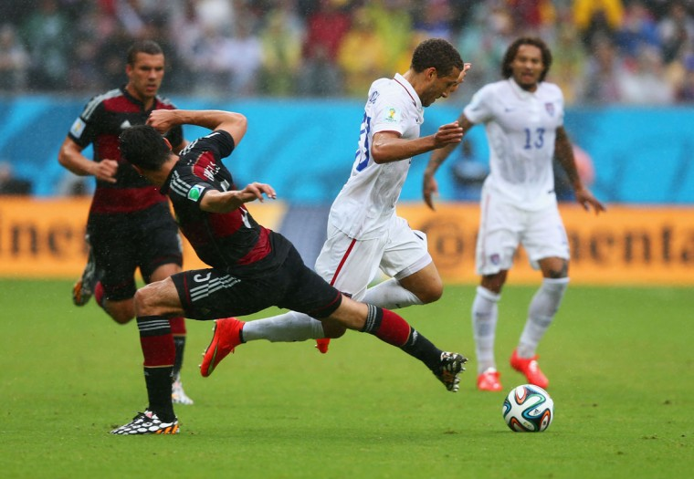 Mats Hummels of Germany challenges Fabian Johnson of the United States during the 2014 FIFA World Cup Brazil group G match between the United States and Germany at Arena Pernambuco on June 26, 2014 in Recife, Brazil. (Photo by Martin Rose/Getty Images)
