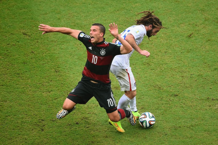 Lukas Podolski of Germany is challenged by Kyle Beckerman of the United States during the 2014 FIFA World Cup Brazil group G match between the United States and Germany at Arena Pernambuco on June 26, 2014 in Recife, Brazil. (Photo by Laurence Griffiths/Getty Images)