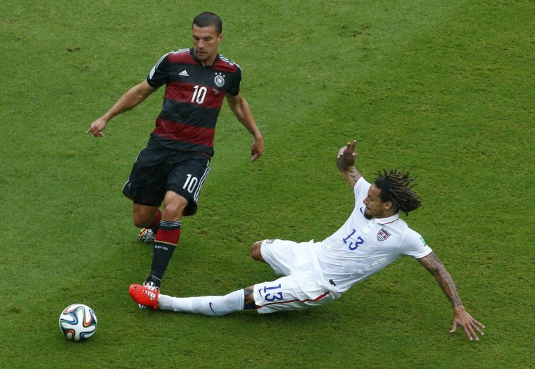 Jermaine Jones of the U.S. (R) fights for the ball with Germany's Lukas Podolski during their 2014 World Cup Group G soccer match at the Pernambuco arena in Recife June 26, 2014. (Ruben Sprich/Reuters)