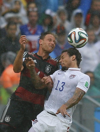 Jermaine Jones (R) of the U.S. jumps for the ball with Germany's Benedikt Hoewedes during their 2014 World Cup Group G soccer match at the Pernambuco arena in Recife June 26, 2014. (Brian Snyder/Reuters)
