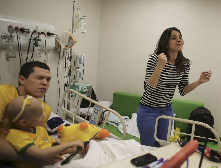 Brazilian patient Isabela (C), 4, and her parents Thiago (L) and Luciana, react as they watch the 2014 World Cup Group A soccer match between Brazil and Mexico at the Cancer Itaci Hospital in Sao Paulo June 17, 2014. (Nacho Doce/Reuters)