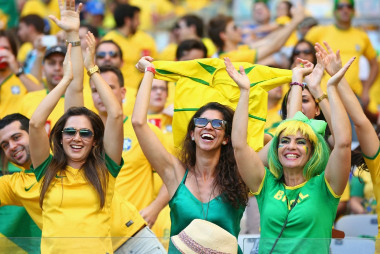 Brazil fans enjoy the atmosphere prior to the 2014 FIFA World Cup Brazil round of 16 match between Brazil and Chile at Estadio Mineirao on June 28, 2014 in Belo Horizonte, Brazil. (Photo by Quinn Rooney/Getty Images)