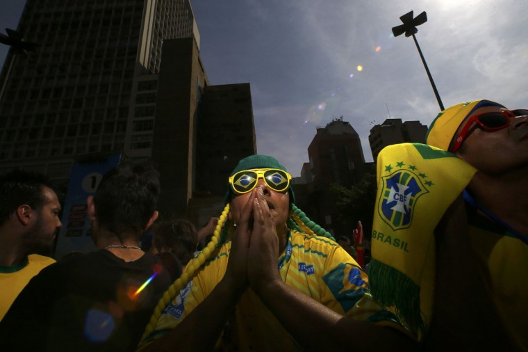 Brazil fan prays before telecast of Brazil Chile soccer match in Sao Paulo