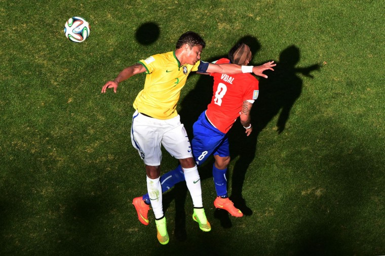 Thiago Silva of Brazil and Arturo Vidal of Chile go up for a header during the 2014 FIFA World Cup Brazil round of 16 match between Brazil and Chile at Estadio Mineirao on June 28, 2014 in Belo Horizonte, Brazil. (Photo by Francois Xavier Marit - Pool/Getty Images)
