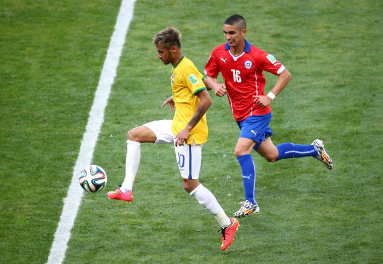 Neymar of Brazil controls the ball as Felipe Gutierrez of Chile gives chase during the 2014 FIFA World Cup Brazil round of 16 match between Brazil and Chile at Estadio Mineirao on June 28, 2014 in Belo Horizonte, Brazil. (Photo by Ian Walton/Getty Images)