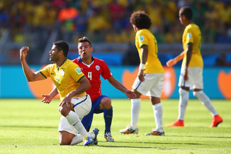 Hulk of Brazil and Mauricio Isla of Chile react during the 2014 FIFA World Cup Brazil round of 16 match between Brazil and Chile at Estadio Mineirao on June 28, 2014 in Belo Horizonte, Brazil. (Photo by Paul Gilham/Getty Images)