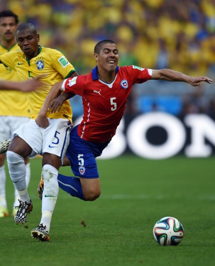 Chile's midfielder Francisco Silva (R) challenges Brazil's midfielder Fernandinho during the round of 16 football match between Brazil and Chile at The Mineirao Stadium in Belo Horizonte during the 2014 FIFA World Cup on June 28, 2014. (Vanderlei Almeida/AFP/Getty Images)