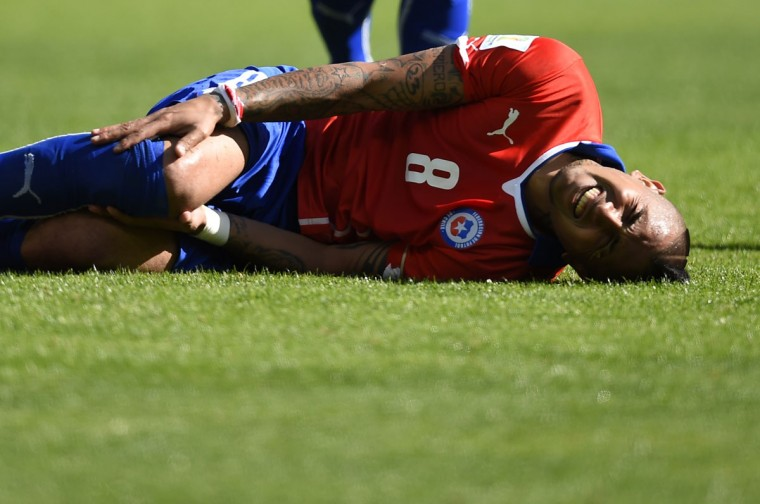 Chile's midfielder Arturo Vidal reacts after falling during the round of 16 football match between Brazil and Chile at The Mineirao Stadium in Belo Horizonte during the 2014 FIFA World Cup on June 28, 2014. (Fabrice Coffrini/AFP/Getty Images)