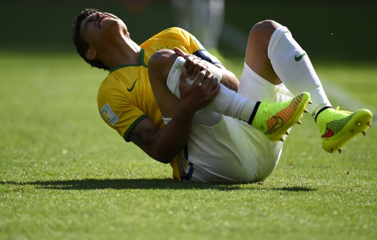 Brazil's defender and captain Thiago Silva reacts after falling during the round of 16 football match between Brazil and Chile at The Mineirao Stadium in Belo Horizonte during the 2014 FIFA World Cup on June 28, 2014. (Fabrice Coffrini/AFP/Getty Images)