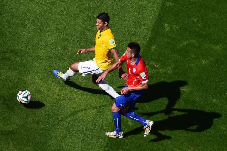 Chile's defender Mauricio Isla (R) challenges Brazil's forward Hulk during the round of 16 football match between Brazil and Chile at The Mineirao Stadium in Belo Horizonte during the 2014 FIFA World Cup on June 28, 2014. (Francois Xavier Marit/AFP/Getty Images)