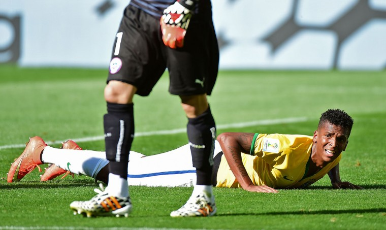 Brazil's forward Jo pushes himself up off the ground during the Round of 16 football match between Brazil and Chile at the Mineirao Stadium in Belo Horizonte during the 2014 FIFA World Cup on June 28, 2014. (Martin Bernetti/AFP/Getty Images)