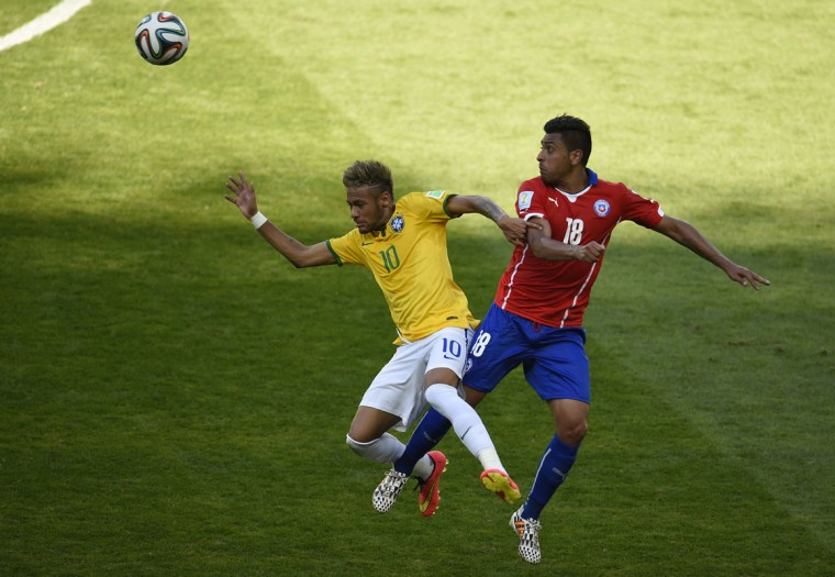 Brazil's forward Neymar (L) and Chile's defender Gonzalo Jara vie for the ball during the Round of 16 football match between Brazil and Chile at the Mineirao Stadium in Belo Horizonte during the 2014 FIFA World Cup on June 28, 2014. (Odd Andersen/AFP/Getty Images)