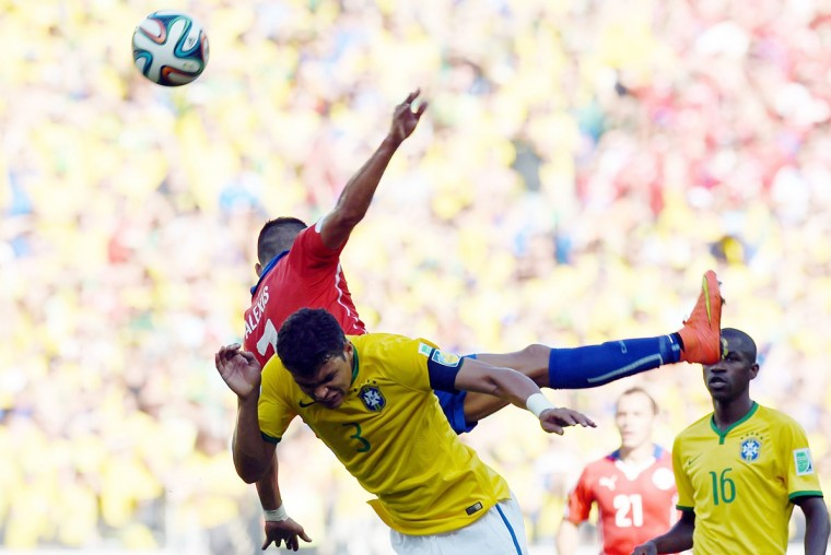 Brazil's defender and captain Thiago Silva (front) challenges Chile's forward Alexis Sanchez during the round of 16 football match between Brazil and Chile at The Mineirao Stadium in Belo Horizonte during the 2014 FIFA World Cup on June 28, 2014. (Vanderlei Almeida/AFP/Getty Images)