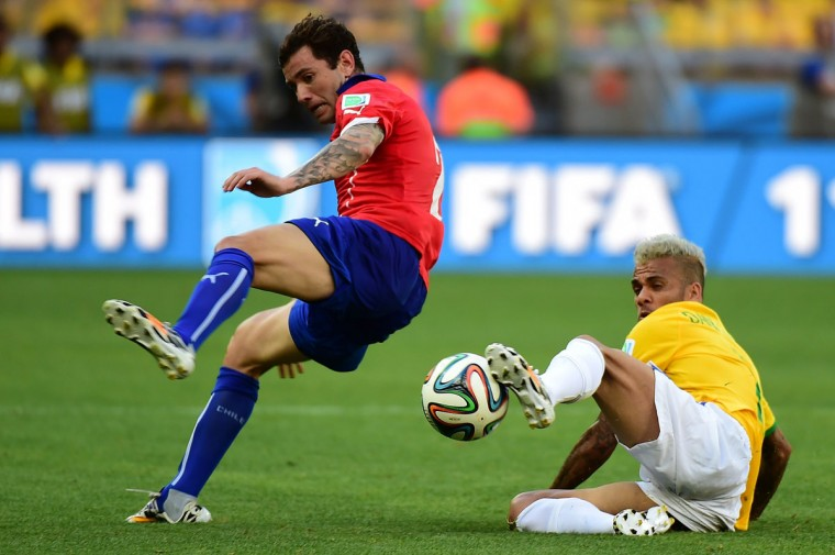 Brazil's defender Dani Alves (R) and Chile's defender Eugenio Mena vie for the ball during the Round of 16 football match between Brazil and Chile at the Mineirao Stadium in Belo Horizonte during the 2014 FIFA World Cup on June 28, 2014. (Martin Bernetti/AFP/Getty Images)