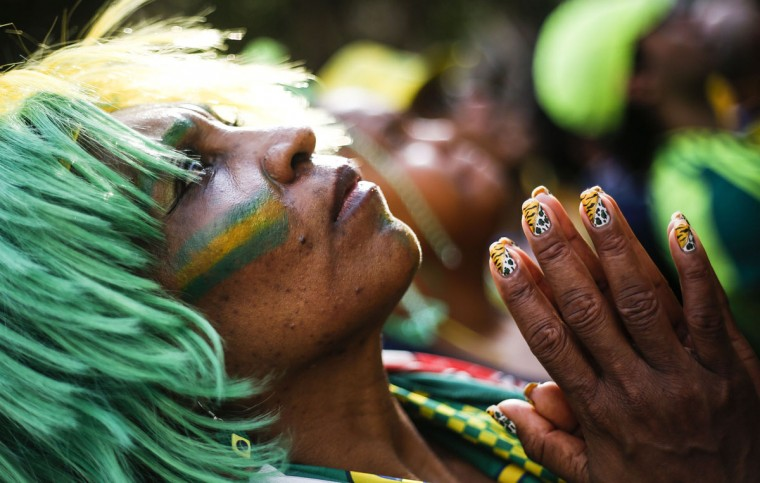 Supporters of the Brazilian national football team attend the 2014 FIFA World Cup Brazil vs Chile, at the FIFA Fan Fest public viewing event in Sao Paulo, Brazil on June 28, 2014. (Miguel Schinicariol/AFP/Getty Images)