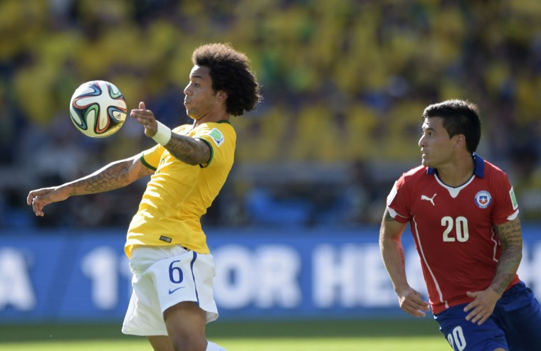 Brazil's defender Marcelo (L) and Chile's midfielder Charles Aranguiz vie for the ball during the Round of 16 football match between Brazil and Chile at the Mineirao Stadium in Belo Horizonte during the 2014 FIFA World Cup on June 28, 2014. (Juan Mabromata/AFP/Getty Images)