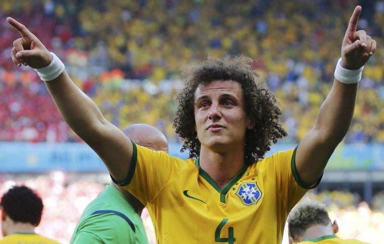 Brazil's David Luiz (front) celebrates his goal against Chile during their 2014 World Cup round of 16 game at the Mineirao stadium in Belo Horizonte June 28, 2014. (Sergio Perez/Reuters)