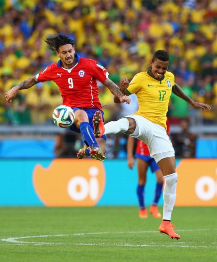Mauricio Pinilla of Chile and Luiz Gustavo of Brazil compete for the ball during the 2014 FIFA World Cup Brazil round of 16 match between Brazil and Chile at Estadio Mineirao on June 28, 2014 in Belo Horizonte, Brazil.  (Photo by Quinn Rooney/Getty Images) Mauricio Pinilla of Chile and Luiz Gustavo of Brazil compete for the ball during the 2014 FIFA World Cup Brazil round of 16 match between Brazil and Chile at Estadio Mineirao on June 28, 2014 in Belo Horizonte, Brazil.  (Photo by Quinn Rooney/Getty Images)