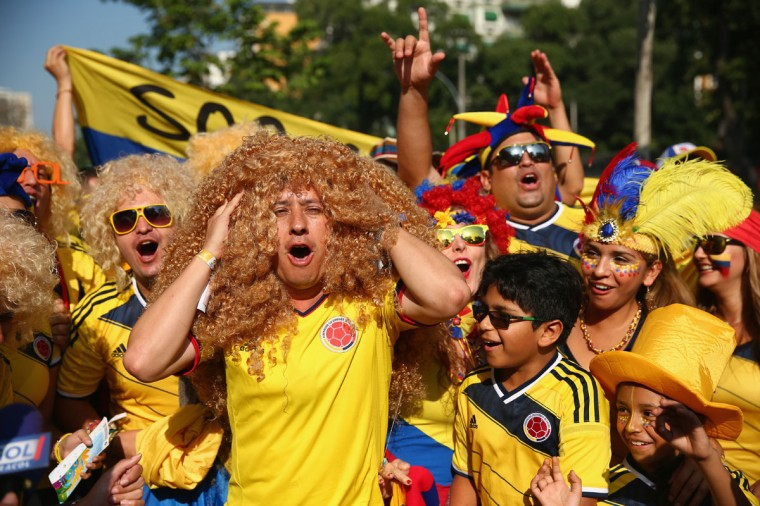 Fans of Colombia pose outside prior to the 2014 FIFA World Cup Brazil round of 16 match between Colombia and Uruguay at Maracana on June 28, 2014 in Rio de Janeiro, Brazil. (Photo by Julian Finney/Getty Images)