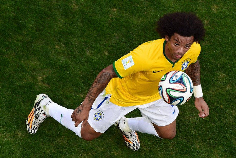 Brazil's defender Marcelo controls the ball during the round of 16 football match between Brazil and Chile at The Mineirao Stadium in Belo Horizonte during the 2014 FIFA World Cup on June 28, 2014. (Francois Xavier Marit/AFP/Getty Images)