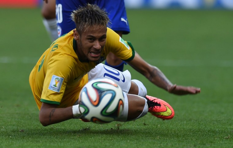 Brazil's forward Neymar falls during the round of 16 football match between Brazil and Chile at The Mineirao Stadium in Belo Horizonte during the 2014 FIFA World Cup on June 28, 2014. (Vanderleo Almeida/AFP/Getty Images)