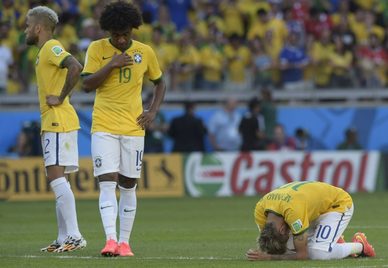 Brazil's forward Neymar (R) and Brazil's midfielder Willian react prior to the penalty shoot out after extra-time in the Round of 16 football match between Brazil and Chile at The Mineirao Stadium in Belo Horizonte during the 2014 FIFA World Cup on June 28, 2014. (Juan Mabromata/AFP/Getty Images)