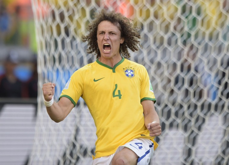Brazil's defender David Luiz celebrates after scoring during the penalty shoot out after extra-time in the Round of 16 football match between Brazil and Chile at The Mineirao Stadium in Belo Horizonte during the 2014 FIFA World Cup on June 28, 2014. (Juan Mabromata/AFP/Getty Images)