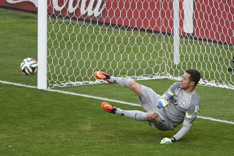 Brazil's goalkeeper Julio Cesar saves a shot by Chile's forward Mauricio Pinilla during the penalty shoot out after extra-time in the Round of 16 football match between Brazil and Chile at The Mineirao Stadium in Belo Horizonte during the 2014 FIFA World Cup on June 28, 2014. (Odd Andersen/AFP/Getty Images)