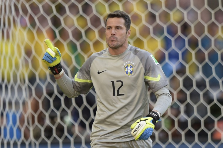 Brazil's goalkeeper Julio Cesar celebrates after saving a shot during the penalty shoot out after extra-time in the Round of 16 football match between Brazil and Chile at The Mineirao Stadium in Belo Horizonte during the 2014 FIFA World Cup on June 28, 2014. (Juan Mabromata/AFP/Getty Images)