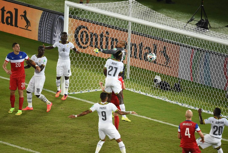 Ghana's goalkeeper Adam Larsen Kwarasey (Center) and Ghana's defender John Boye jump for the ball during a Group G football match between Ghana and US at the Dunas Arena in Natal during the 2014 FIFA World Cup on June 16, 2014. (Javier Soriano/Getty Images)