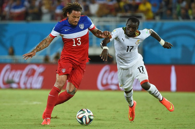 US midfielder Jermaine Jones (Left) jumps for the ball with Ghana's midfielder Mohammed Rabiu (Right) during a Group G football match between Ghana and US at the Dunas Arena in Natal during the 2014 FIFA World Cup on June 16, 2014. (Emmanuel Dunand/Getty Images)