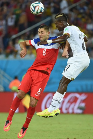 US forward Clint Dempsey (Left) jumps for the ball with Ghana's defender John Boye (Right) during a Group G football match between Ghana and US at the Dunas Arena in Natal during the 2014 FIFA World Cup on June 16, 2014. (Emmanuel Dunand/Getty Images)