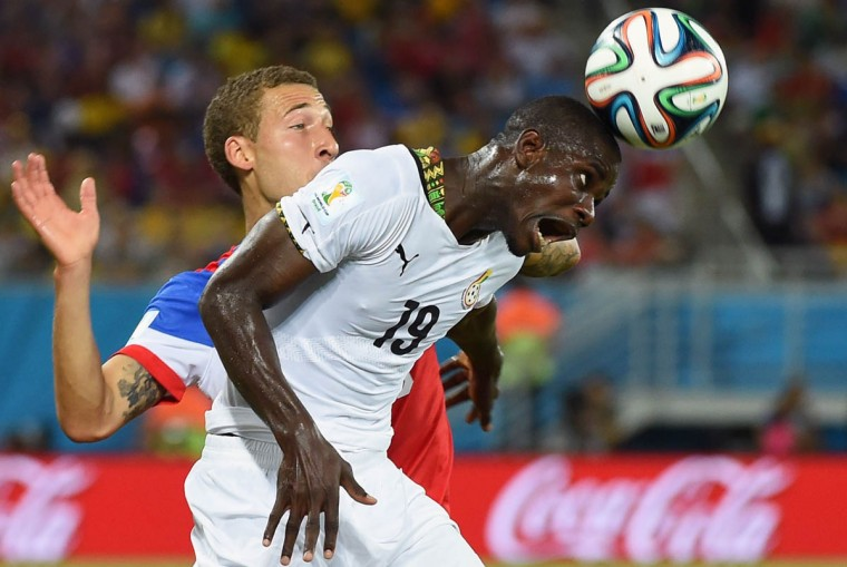 Ghana's defender Jonathan Mensah (Right) heads the ball in front of US defender Fabian Johnson during a Group G football match between Ghana and US at the Dunas Arena in Natal during the 2014 FIFA World Cup on June 16, 2014. (Emmanuel Dunand/Getty Images)