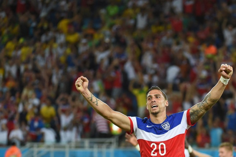 US defender Geoff Cameron celebrates after US defender John Brooks scored during a Group G football match between Ghana and US at the Dunas Arena in Natal during the 2014 FIFA World Cup on June 16, 2014. (Emmanuel Dunand/Getty Images)