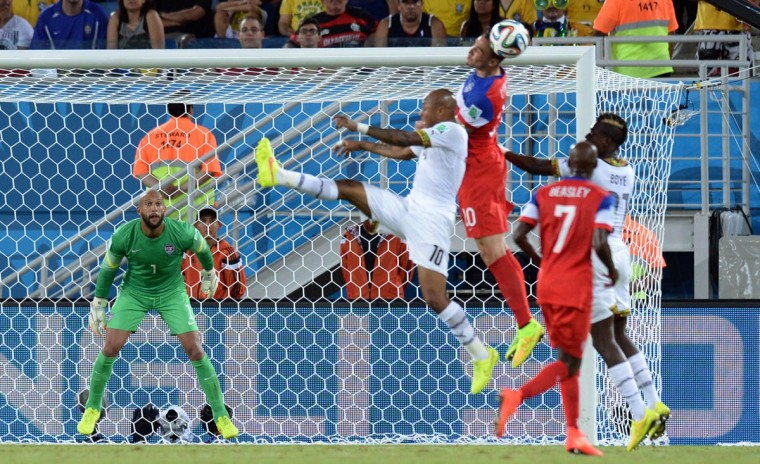 US goalkeeper Tim Howard (Left) eyes the ball during a Group G football match between Ghana and US at the Dunas Arena in Natal during the 2014 FIFA World Cup on June 16, 2014. (Carl De Souza/Getty Images)