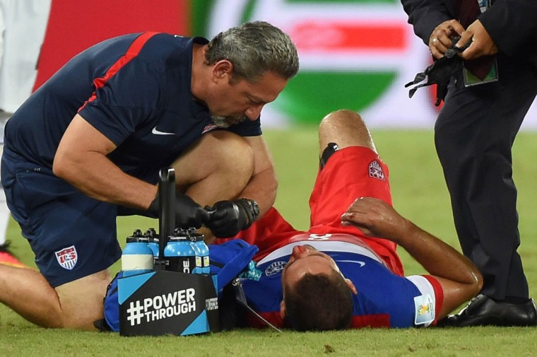 US forward Clint Dempsey (Right) receives medical assistance after colliding with Ghana's defender John Boye during a Group G football match between Ghana and US at the Dunas Arena in Natal during the 2014 FIFA World Cup on June 16, 2014. (Emmanuel Dunand/Getty Images)