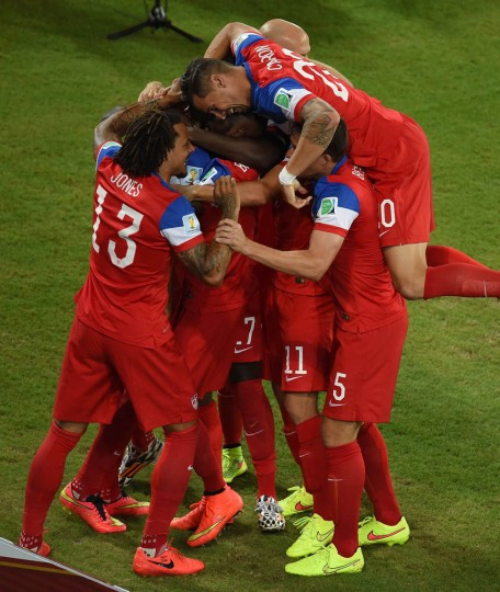US forward Clint Dempsey (Center) celebrates with teammates after scoring during a Group G football match between Ghana and US at the Dunas Arena in Natal during the 2014 FIFA World Cup on June 16, 2014. (Javier Soriano/Getty Images)