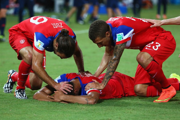 John Brooks of the United States (Center) celebrates scoring his team's second goal with Graham Zusi (Left) and Fabian Johnson (Right) during the 2014 FIFA World Cup Brazil Group G match between Ghana and the United States at Estadio das Dunas on June 16, 2014 in Natal, Brazil. (Kevin C. Cox/Getty Images)