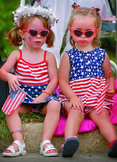 All decked in red, white and blue and waiting for a parade are cousins Megan Wall (left) and Allison Campbell of Catonsville, July 4, 2001. (Baltimore Sun photo by Francis Gardler)