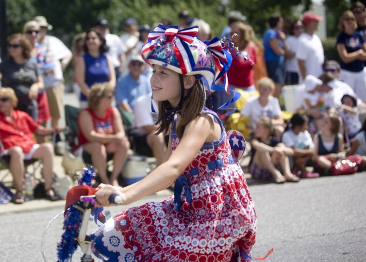 MacKenzie Moffet, 8, a student at Hillcrest Elementary, rides her bike behind the Hillcrest parade entry in the 63rd annual Catonsville Fourth of July parade in 2009. (Staff photo by Sarah Nix)