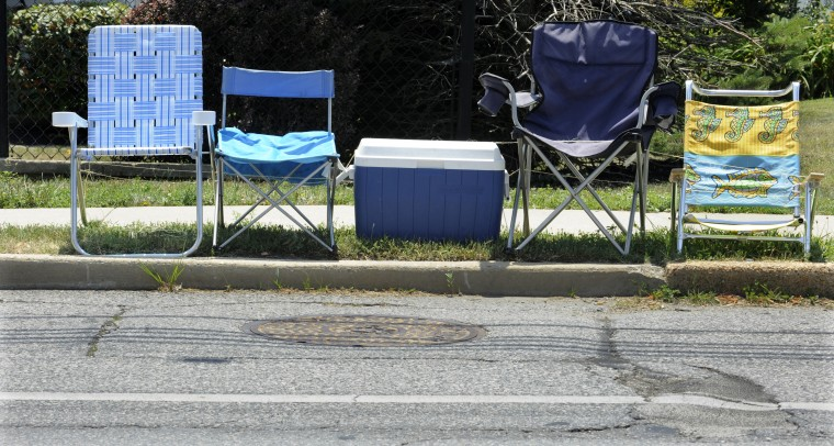 Days before the Fourth of July parade marches through Catonsville in 2011, the parade of chairs and blankets begins as residents stake out their viewing spots along Frederick Road and Bloomsbury Avenue. (Baltimore Sun photo by Jed Kirschbaum)