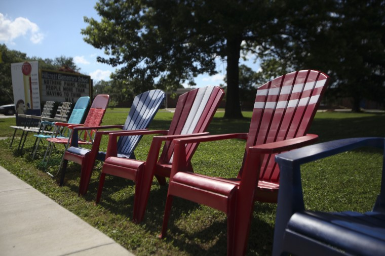 Chairs reserve space for the 4th of July parade on Frederick Road near Hillcrest Elementary School in Catonsville in 2013. (Monica Herndon/BSMG)
