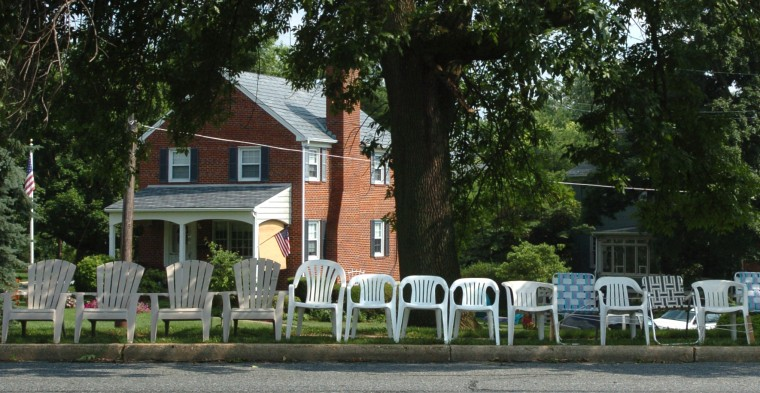 Lawn chairs are already set up along Frederick Road in preparation of the annual Fourth of July parade in 2006. These chairs are at the corner of Park Drive and Forest Drive and Frederick Roads. (Baltimore Sun staff / Algerina Perna)