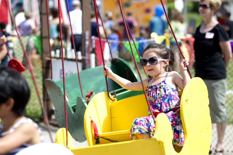 Quinn McCauley, 4, of Odenton hangs on while on a ride during the 136th annual Clarksville Picnic at St. Louis Catholic Church in Clarksville, MD on Saturday, June 28, 2014. (Jen Rynda/BSMG)