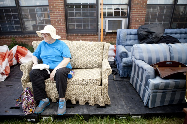 Barbara Woulfe of Annapolis takes a break and sits on couches for sale during the 136th annual Clarksville Picnic at St. Louis Catholic Church in Clarksville, MD on Saturday, June 28, 2014. (Jen Rynda/BSMG)