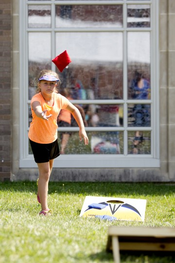 Rebecca Korkosz, 9, of Clarksville tosses a bean bag during the 136th annual Clarksville Picnic at St. Louis Catholic Church in Clarksville, MD on Saturday, June 28, 2014. (Jen Rynda/BSMG)