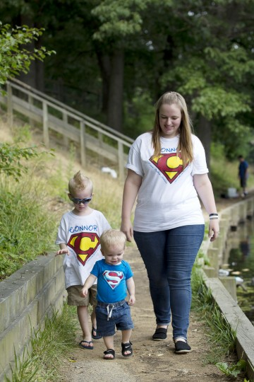Connor Berry, 22 months, of Lansdowne leads the way while walking with his brother Camden Berry, left, 5, and mother Caitie Berry at Hillcrest Park in Lansdowne, MD on Thursday, July 3, 2014. (Jen Rynda/BSMG)